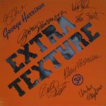 Exceptional quality copy of George Harrison's Extra Texture LP. Strong clear signatures to the front cover.