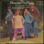 Very good condition copy of 20 Greatest Hits by The Mamas and The Papas, hand signed to the front in blue pen by Michelle Phillips